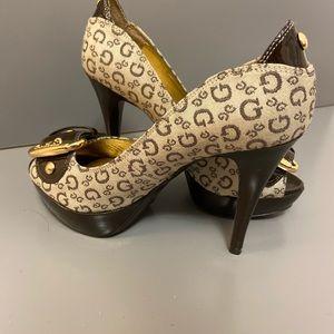 Guess peep toe heels.Glossy dark brown size 5
